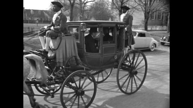 Three shots from moving vehicle of oldfashioned coach pulled by horses carrying philanthropist John D Rockefeller III and Governor of Virginia James...