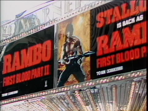 """vídeos de stock e filmes b-roll de three shots of a movie theater marquee that has side-by-side signs for the films """"rambo"""" and """"rambo: first blood part ii"""". - filme de ação"""