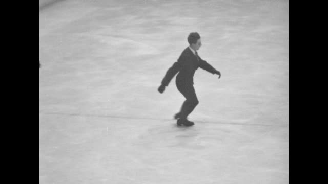 three shots of austria's karl schafer performing figure skating routine in olympic arena / note exact day not known - 1932 winter olympics lake placid stock videos and b-roll footage
