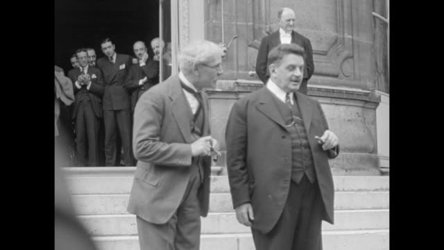 three shots of british prime minister ramsay macdonald on left and french prime minister edouard herriot standing together on steps of the ministry... - 1932 stock videos & royalty-free footage