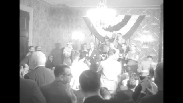 vidéos et rushes de three shots of candidate gov happy chandler speaking to room full of delegates / chandler supporters standing and applauding / female supporter... - adlai stevenson