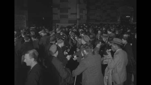 three shots of crowd of rescued seamen milling about in grand central station / cu seamen carrying duffel bag on shoulder / two closeups of rescued... - shoulder bag stock videos & royalty-free footage