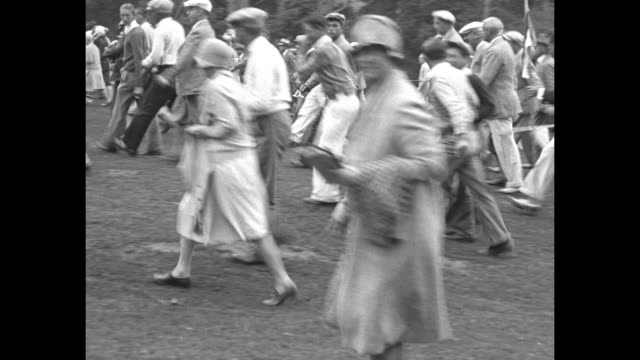 "three shots of crowd walking along course following golfers during the us amateur championship / harrison r. ""jimmy"" johnston hits ball out of sand... - amateur stock videos & royalty-free footage"