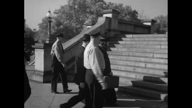 "three shots of exterior of library of congress / mar samuel carrying briefcase with scrolls in it walking up steps to library with policemen us... - newsreel ""dead sea scrolls video stock e b–roll"