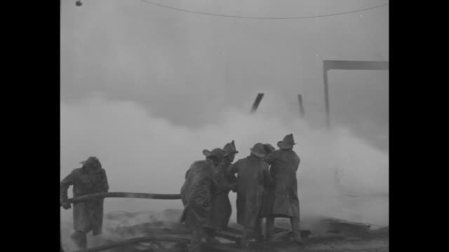 three shots of firemen spraying water from hoses on fire at golden city amusement park in canarsie, brooklyn / firemen looking up at fire, frozen... - fire hose stock videos & royalty-free footage