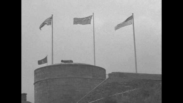 Three shots of flags of Britain US and the Canadian Red Ensign flying on flagpoles atop La Citadelle / Note exact day not known