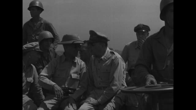 Three shots of Gen Douglas MacArthur and Philippines President Sergio Osmena sitting next to one another in landing barge headed towards shore of...