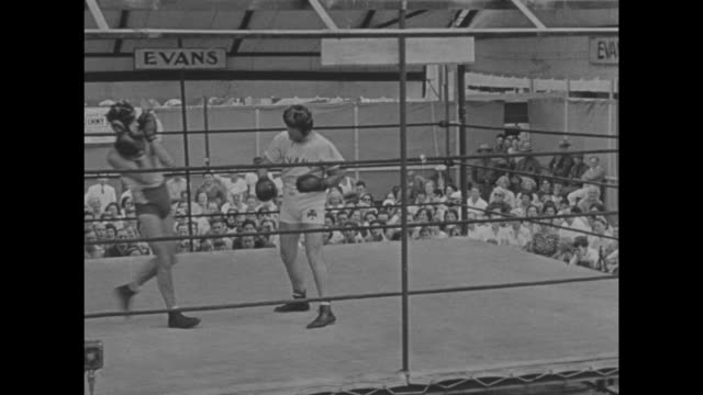 three shots of heavyweight boxer james j. braddock boxing with sparring partner/ braddock talking to camera / note: exact month/day not known - pesi massimi video stock e b–roll