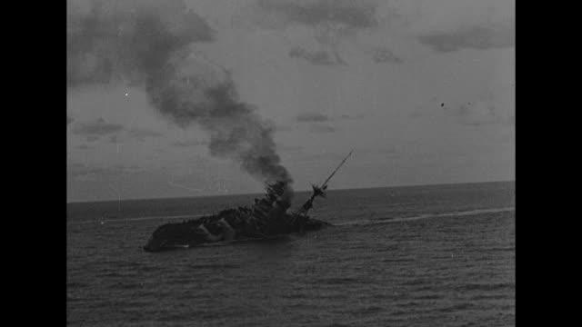 three shots of hms barham listing after being hit by torpedoes smoke rising from ship / ship slowly rolls over then explodes / two shots of huge... - militära fartyg bildbanksvideor och videomaterial från bakom kulisserna