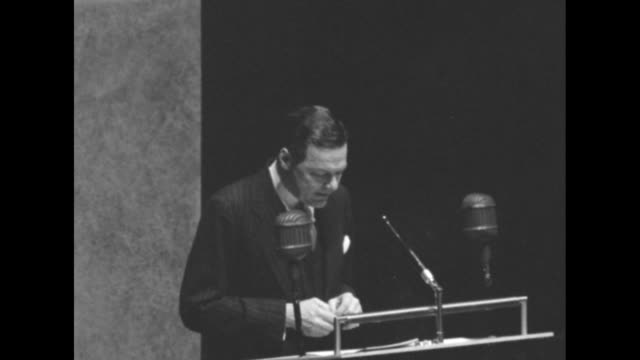 Three shots of Lodge standing at podium speaking about the privilege against selfincrimination and the rule of law and rights of individuals against...