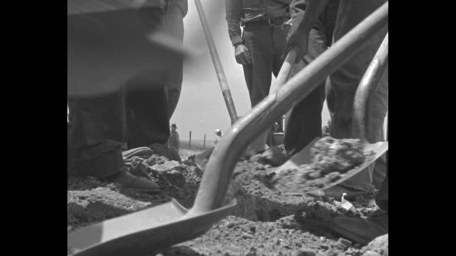 three shots of men working on road digging with shovels as they perform works progress administration work / close shot of man digging with shovel /... - dust bowl stock videos and b-roll footage