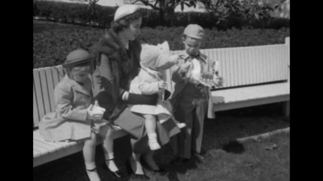 vídeos de stock, filmes e b-roll de three shots of mother barbara jean, pres. dwight eisenhower's daughter-in-law, sitting on bench in front of white house with her children, anne on... - gravata borboleta