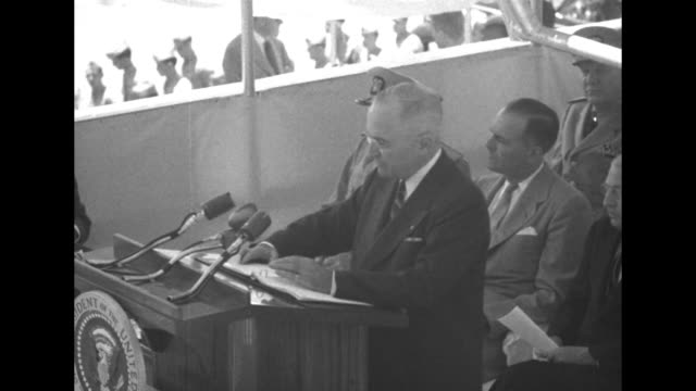 three shots of pres harry truman standing at podium speaking at ceremony for the laying of the keel of atomic submarine uss nautilus - groton connecticut stock videos & royalty-free footage