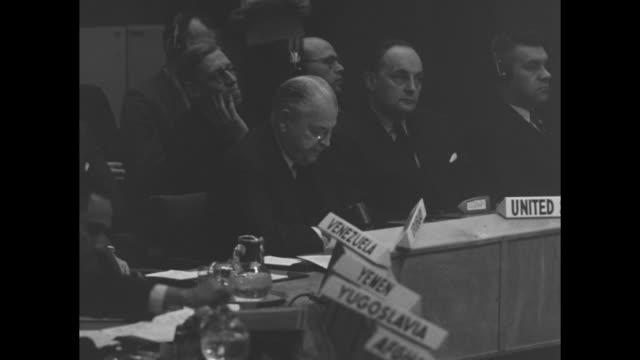 Three shots of William R Austin US Ambassador to UN speaking urging UN action regarding Chinese Communist military invasion of Korea to assist North...