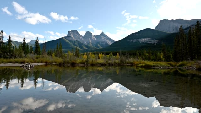 three sisters mountain with autumn forest reflection on pond in canmore at banff national park - tied bow stock videos & royalty-free footage