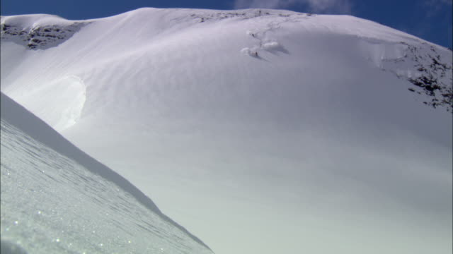 ws, ha, three skiers gliding down mountainside, cariboo and monashee mountains, british columbia, canada - track imprint stock videos and b-roll footage