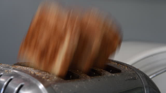 three slices of brown toast popping out of a toaster - small group of objects stock videos & royalty-free footage