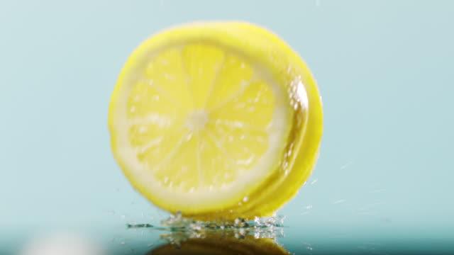 three slices of lemon falling down - lemon stock videos & royalty-free footage