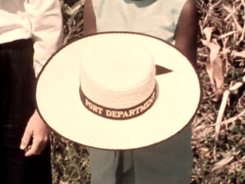 three small children present the queen with a straw hat during her visit to mahe 1972 - straw hat stock videos & royalty-free footage