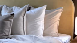 Three small pillows on the head of the bed