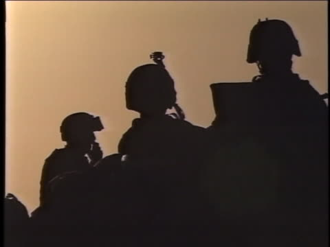 three soldiers stand in silhouette. - al fallujah stock videos & royalty-free footage