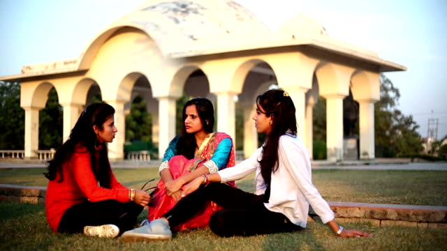 Three some of friend talking to each other