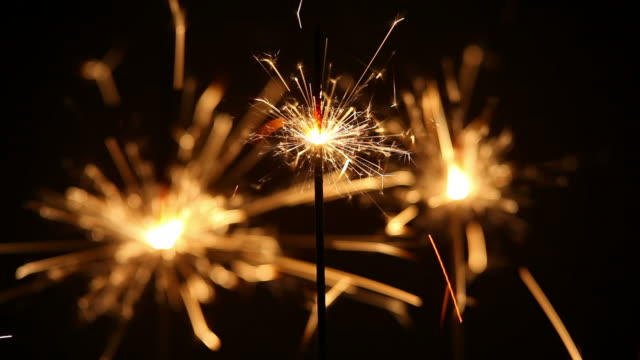 Three Sparklers Burning Down Close-up