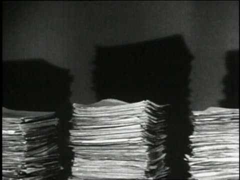 1940 cu three stacks of patent applications growing taller / united states - dokument stock-videos und b-roll-filmmaterial
