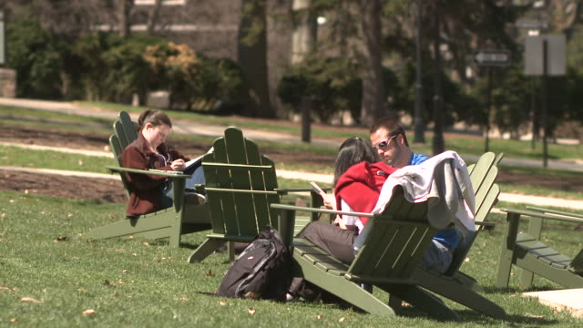 ms three students sitting on deck chairs on campus lawn, bethlehem, pennsylvania, usa - see other clips from this shoot 1503 stock videos and b-roll footage
