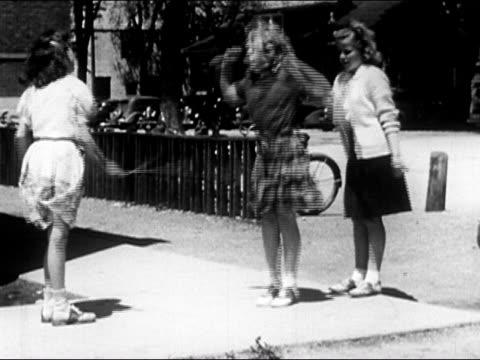 1950 three teenage girls jumping rope on sidewalk / usa / audio - only teenage girls stock videos & royalty-free footage