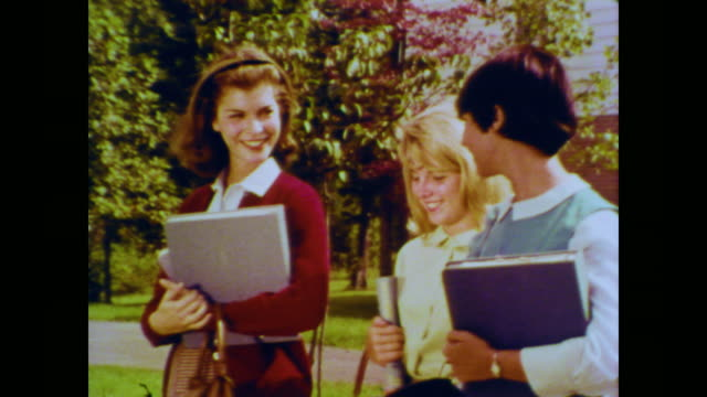 1966 three teenage girls walking home discussing grocery shopping with mother - 1966 stock videos & royalty-free footage