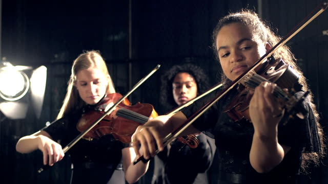 three teenage violinists performing - female high school student stock videos & royalty-free footage