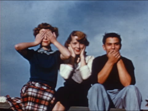 1953 three teenagers in 'see no evil, hear no evil, speak no evil' pose - 1953 stock videos & royalty-free footage