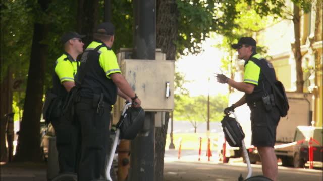 zo ws three transit security workers riding segways down sidewalk / portland, oregon, usa - portland oregon old town stock videos & royalty-free footage