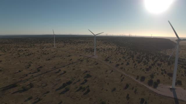 Three turbines backlight by sun