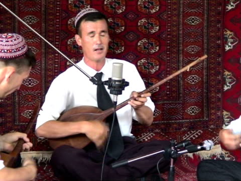 ms three turkmen musicians performing dutar and singing during bakhshi musical contest ashghabad turkmenistan audio - only mid adult men stock videos & royalty-free footage