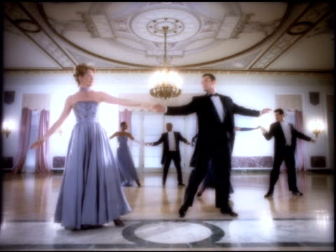 three unidentifiable partners elegantly dressed in triangle formation in elaborate ballroom hall chandeliers curtains dancing females swinging males... - ballroom dancing stock videos & royalty-free footage