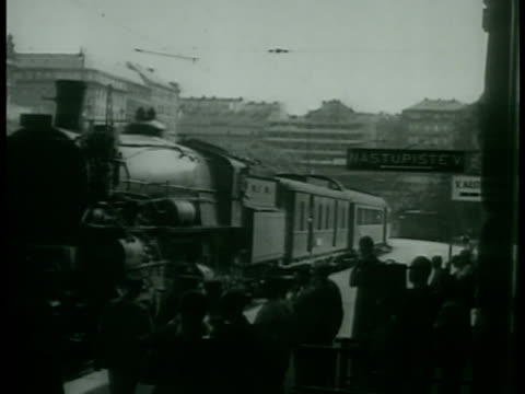 stockvideo's en b-roll-footage met london england three unidentified men having tea coffee at table in room prague ws train moving into station british diplomat lord walter runciman... - 1938