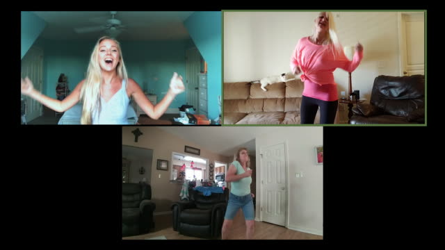 three upbeat women dance in their homes together while video chatting. - only teenage girls stock videos & royalty-free footage