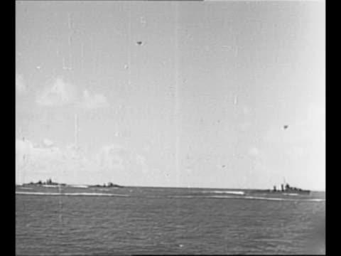three us destroyers move in ocean as military plane flies overhead during world war ii / destroyer sails / rear shot destroyer sails / aircraft... - vermeidung stock-videos und b-roll-filmmaterial