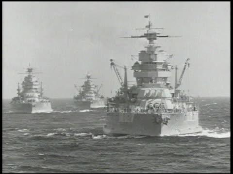 three u.s. navy naval battleships moving at sea. aerial flying passing carrier ship at sea, ocean. world war ii, wwii, warship - us navy stock videos & royalty-free footage