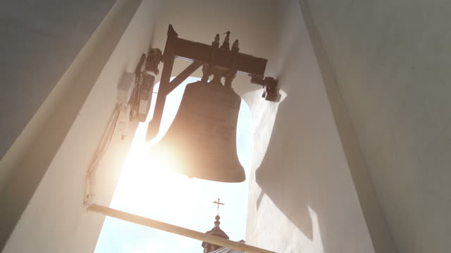three videos of church bells in 4k - church stock videos & royalty-free footage