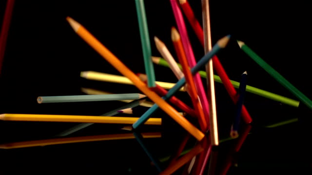 Three videos of falling crayons in real slow motion