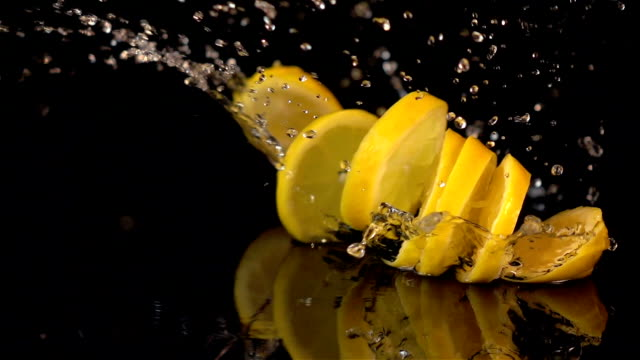 Three videos of falling lemon slices in real slow motion
