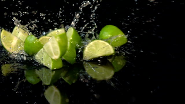 three videos of falling lime in real slow motion - lime stock videos and b-roll footage