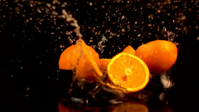 Three videos of falling oranges in real slow motion