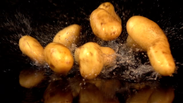 three videos of falling potatoes in real slow motion - raw potato stock videos & royalty-free footage