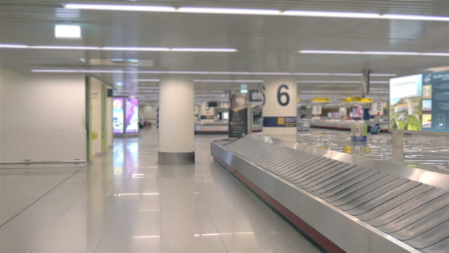 three videos of luggage carousel in 4k - receiving stock videos & royalty-free footage