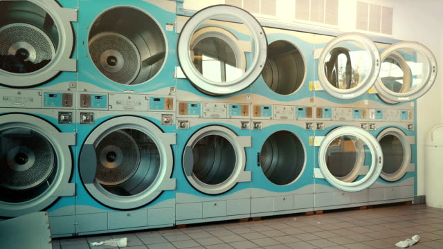 three videos of self-service laundry - coin laundry - launderette stock videos & royalty-free footage