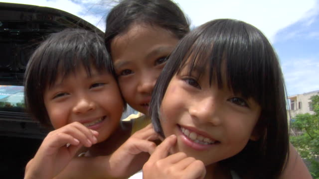 cu three vietnamese girls looking at camera, hoian, vietnam - preschool student stock videos and b-roll footage